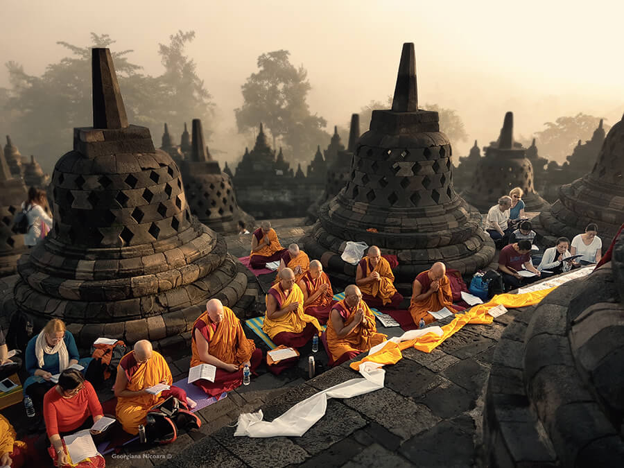 buddhist monks praying at borobudur temple