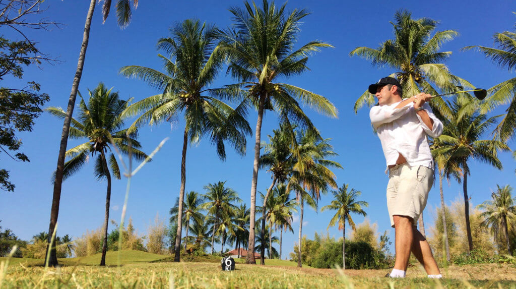 golf palm trees man hitting ball